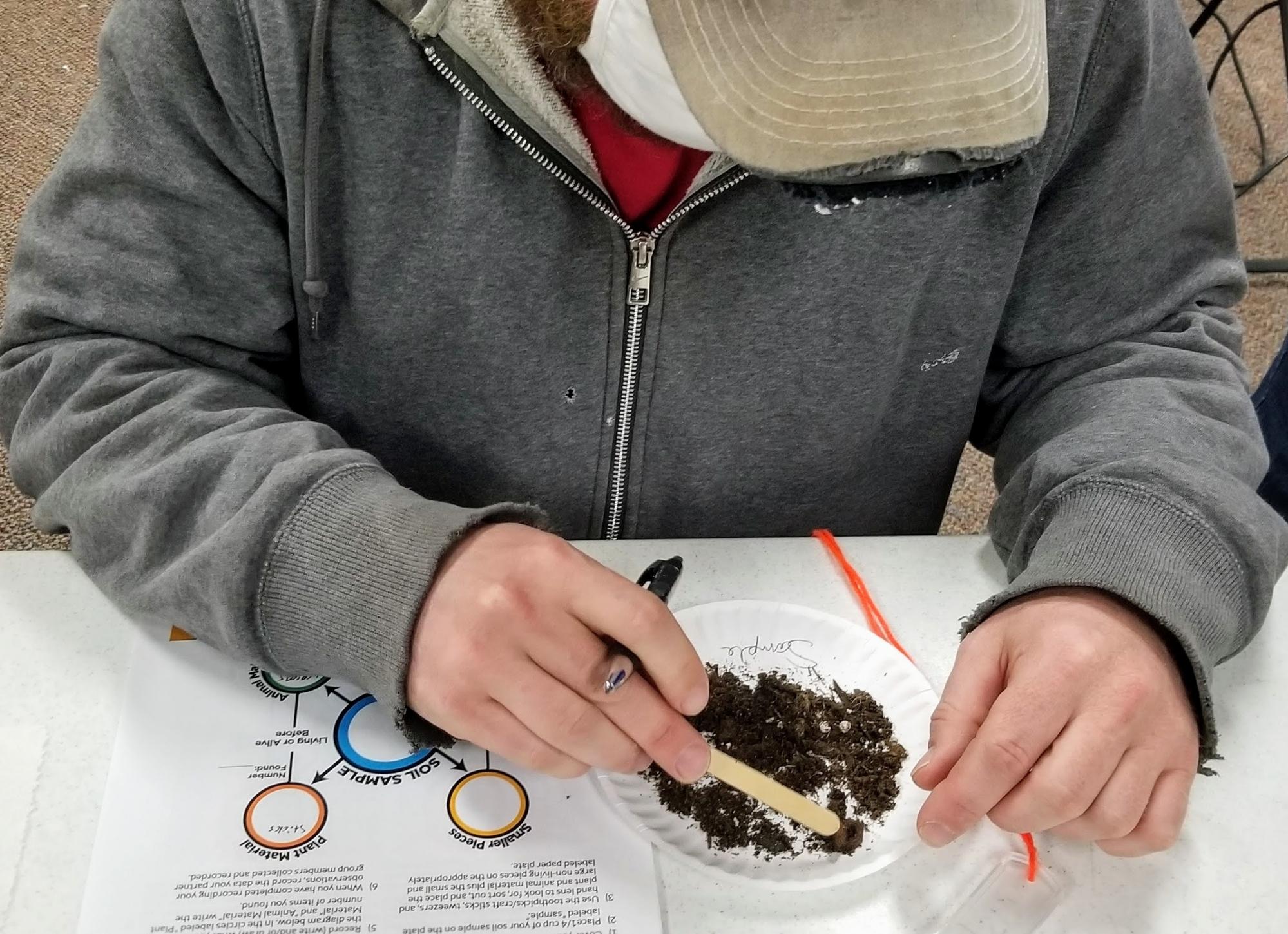 Educators examines soils.